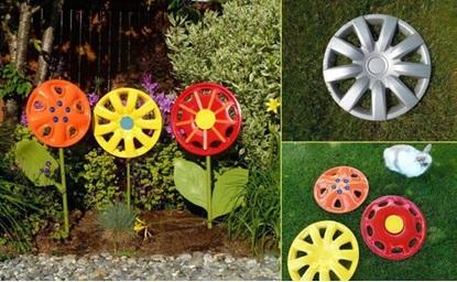 Разноцветные цветы из колесных дисков
